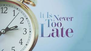"Image of gold pocket watch on blue back ground with the text ""it is never too late"""